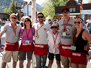 Ticket booth volunteers posing for picture at BBQ Challenge