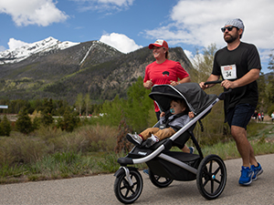 Man and woman running with stroller in 2019 Bacon Burner
