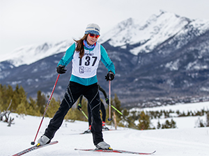 Woman skate skiing on trail in Frisco Gold Rush race