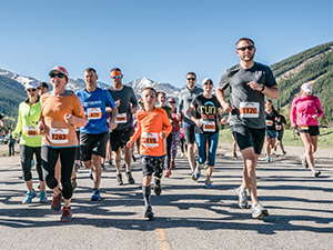 Runners at the start of the 2018 Run the Rockies road races