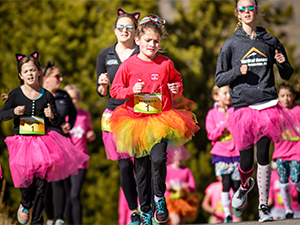 Group of girls and women running in Frisco Girls on the Run 5k