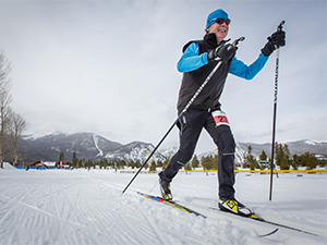 Man Nordic skiing in race at Frisco Nordic Center
