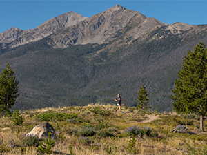 Runner on trail at Frisco Peninsula with Ten Mile Mountain Range in background